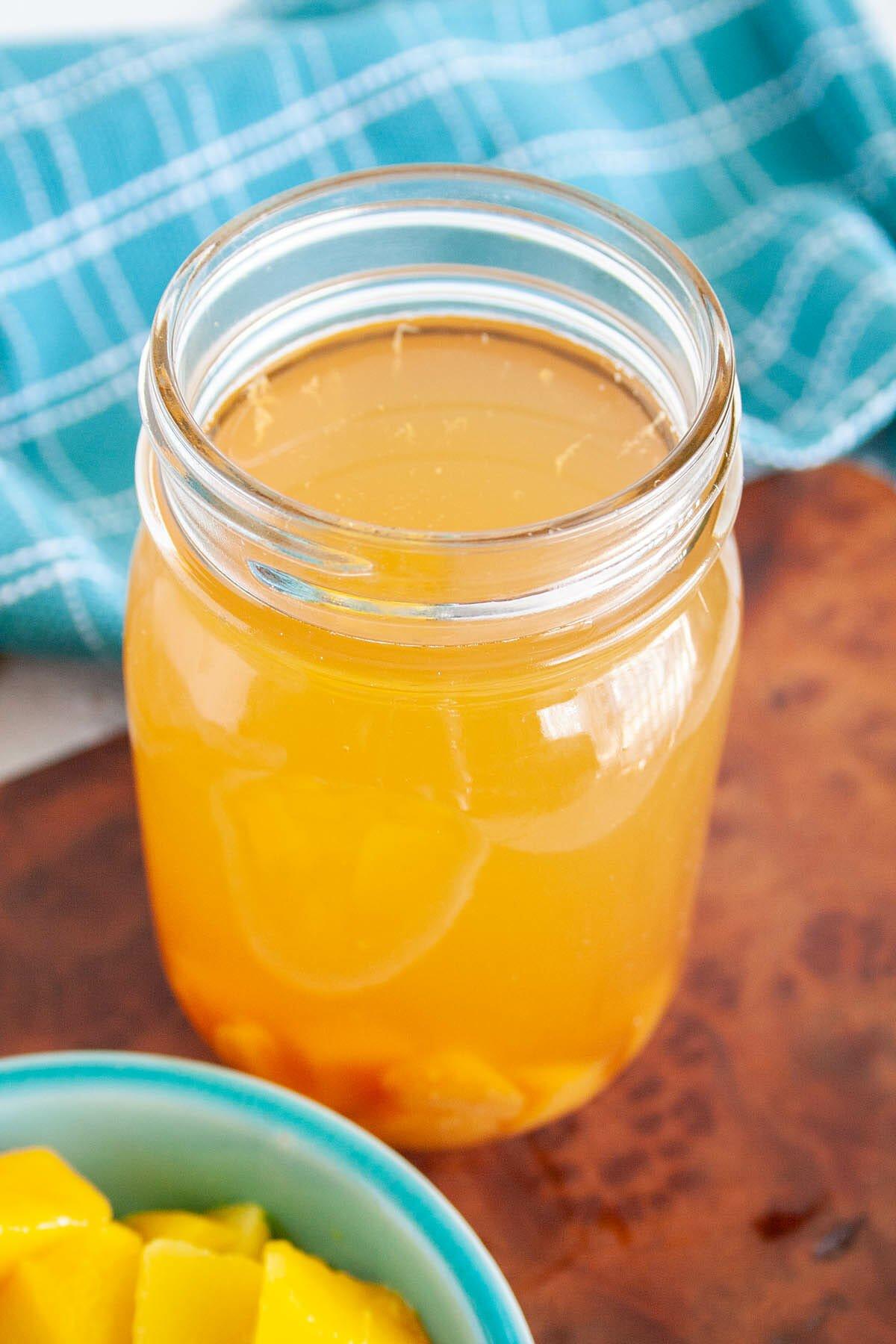 Mango Kombucha in mason jar.