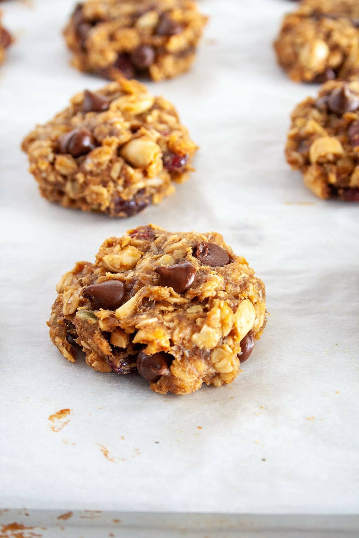 Trail Mix Cookies on a parchment lined baking sheet.