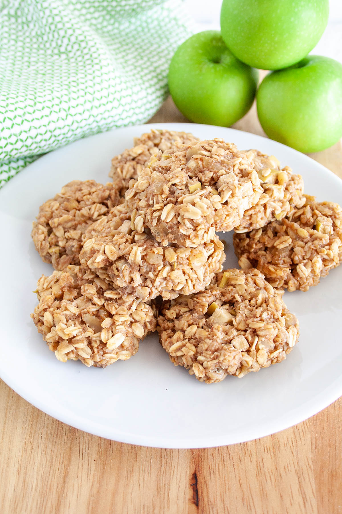 Apple Oatmeal Cookies on plate with Granny Smith apples in the background.