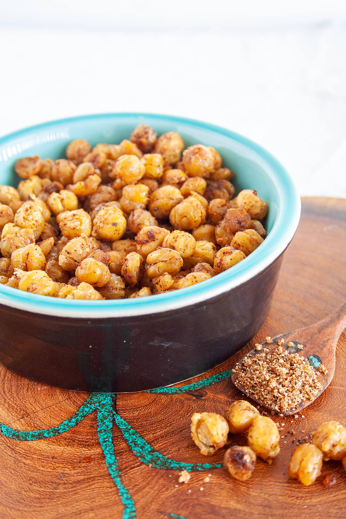 BBQ Roasted Chickpeas close up with spoonful of BBQ seasoning next to it.