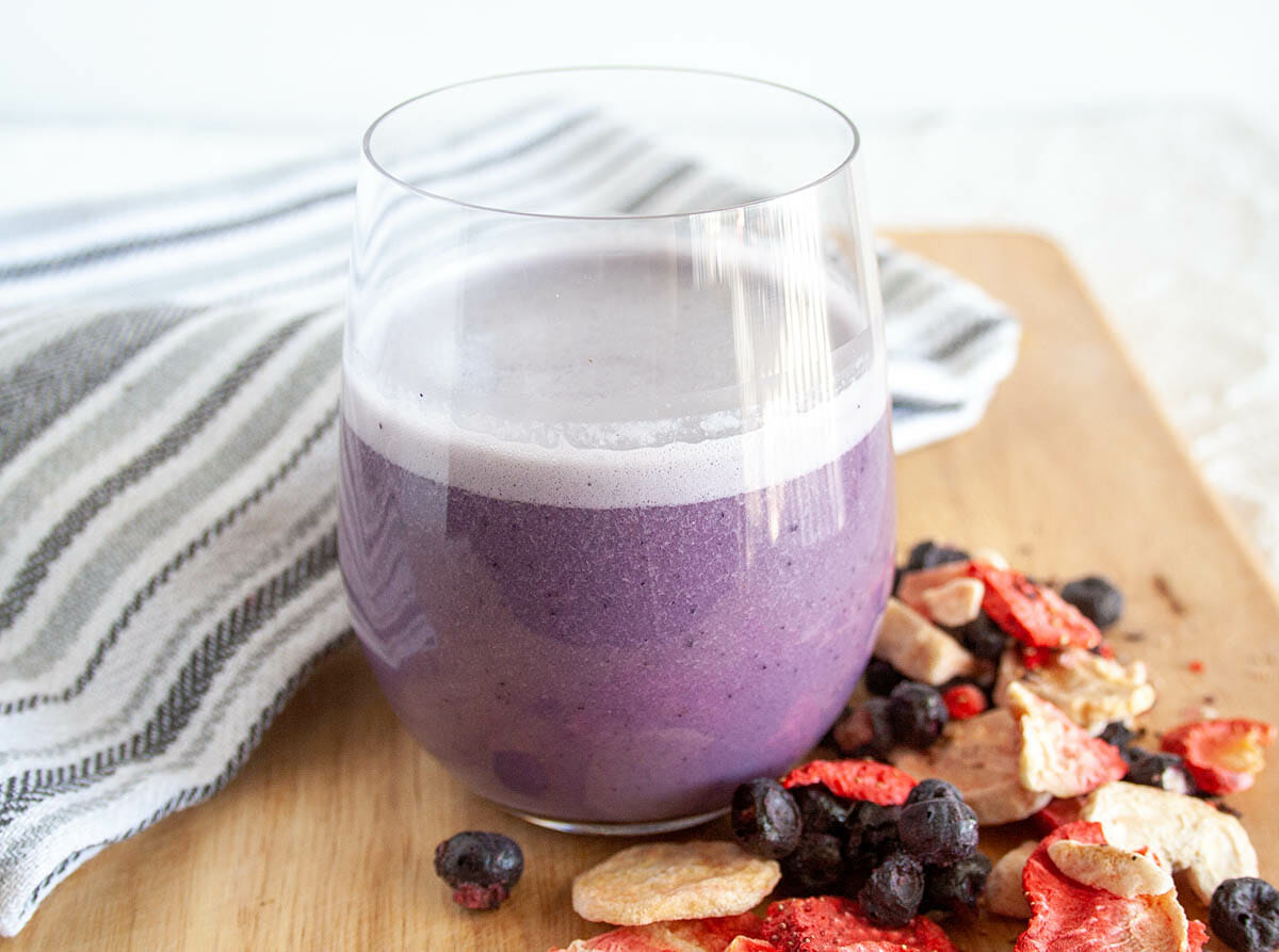 Fruity Almond Milk with freeze dried fruit in foreground.