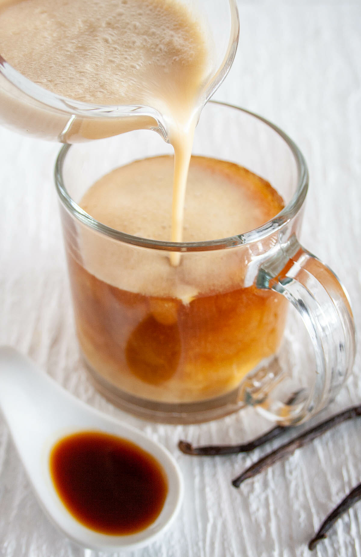 Vanilla Creamer being poured into coffee.