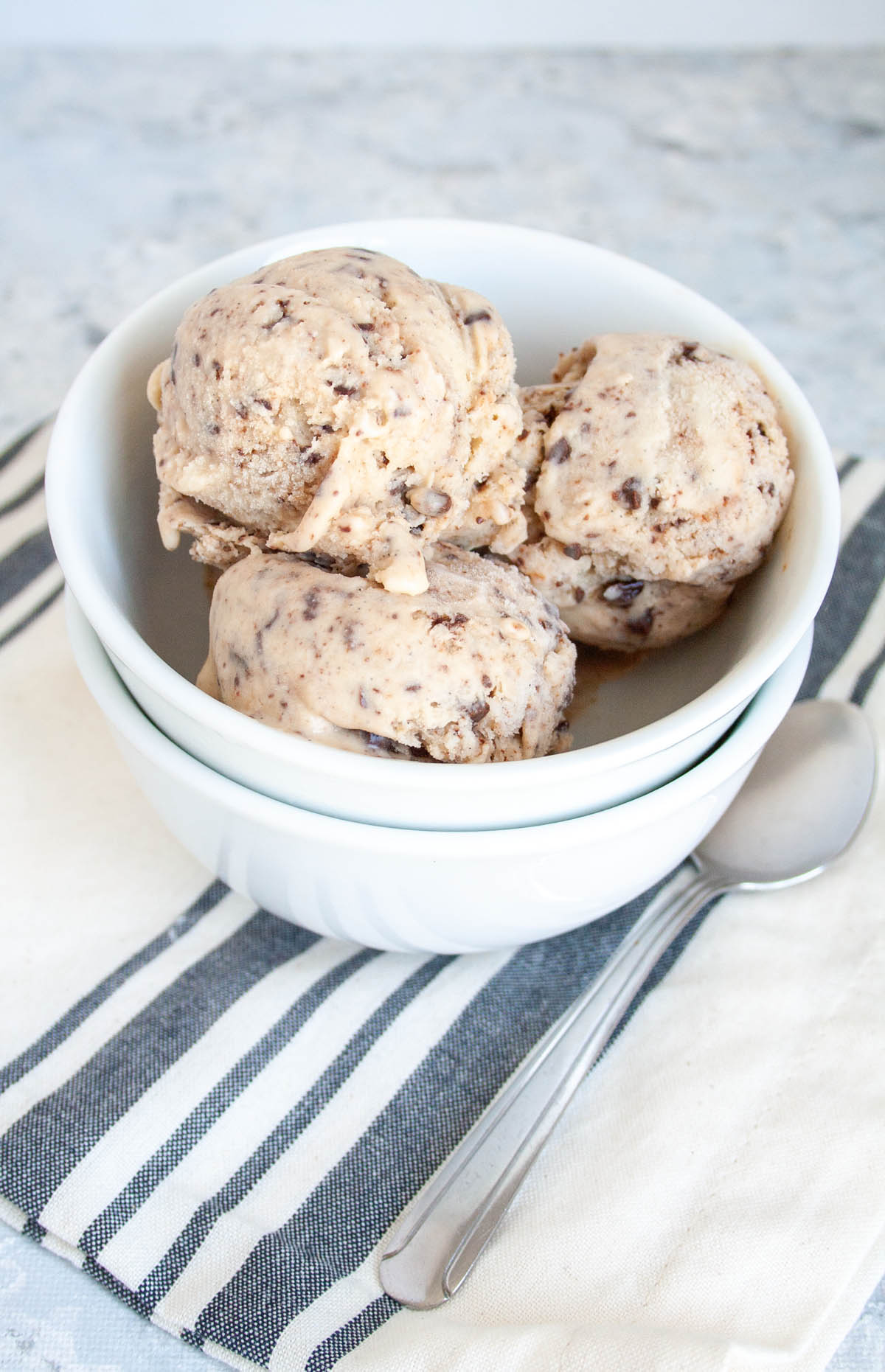 Vegan Chocolate Chip Ice Cream in bowl stacked on an empty bowl.