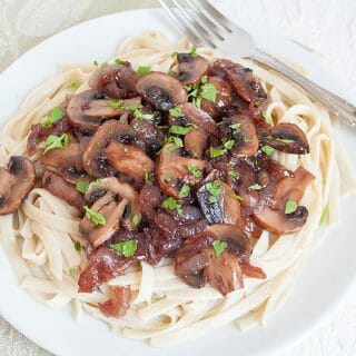 Caramelized Onion and Mushroom Pasta (vegan, gluten free) - This rich vegan gluten free pasta is perfect for date night. It has only a few ingredients, but tastes like it came from a restaurant.