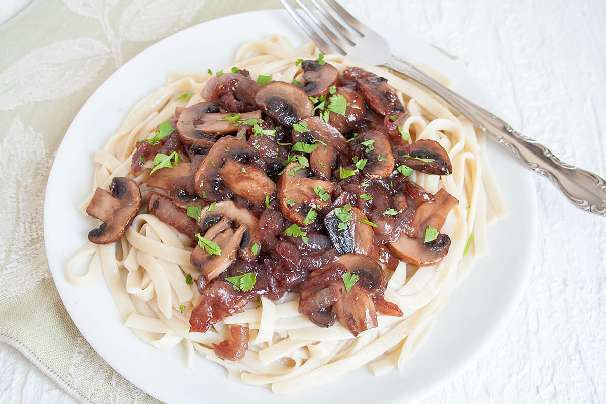 Caramelized Onion and Mushroom Pasta with fork.