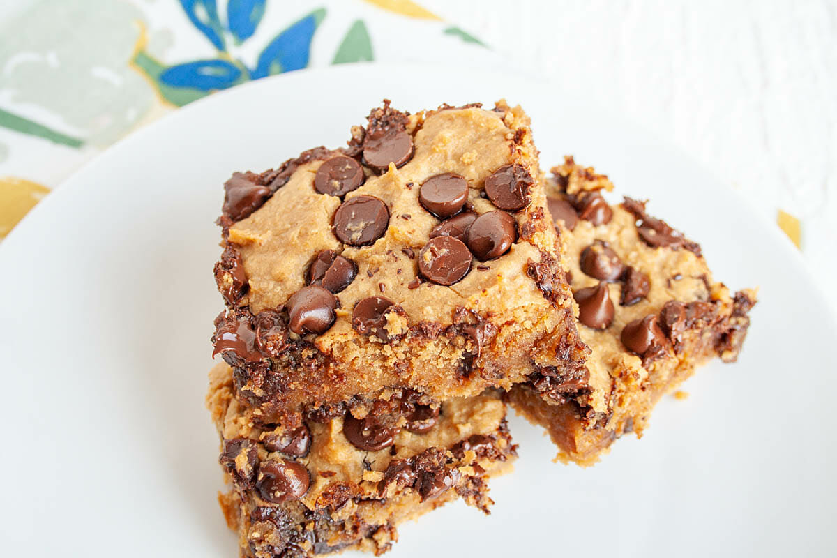 Chickpea Blondies stacked on a plate.