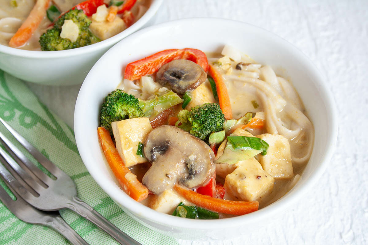 Green Curry with Tofu and Vegetables close up.