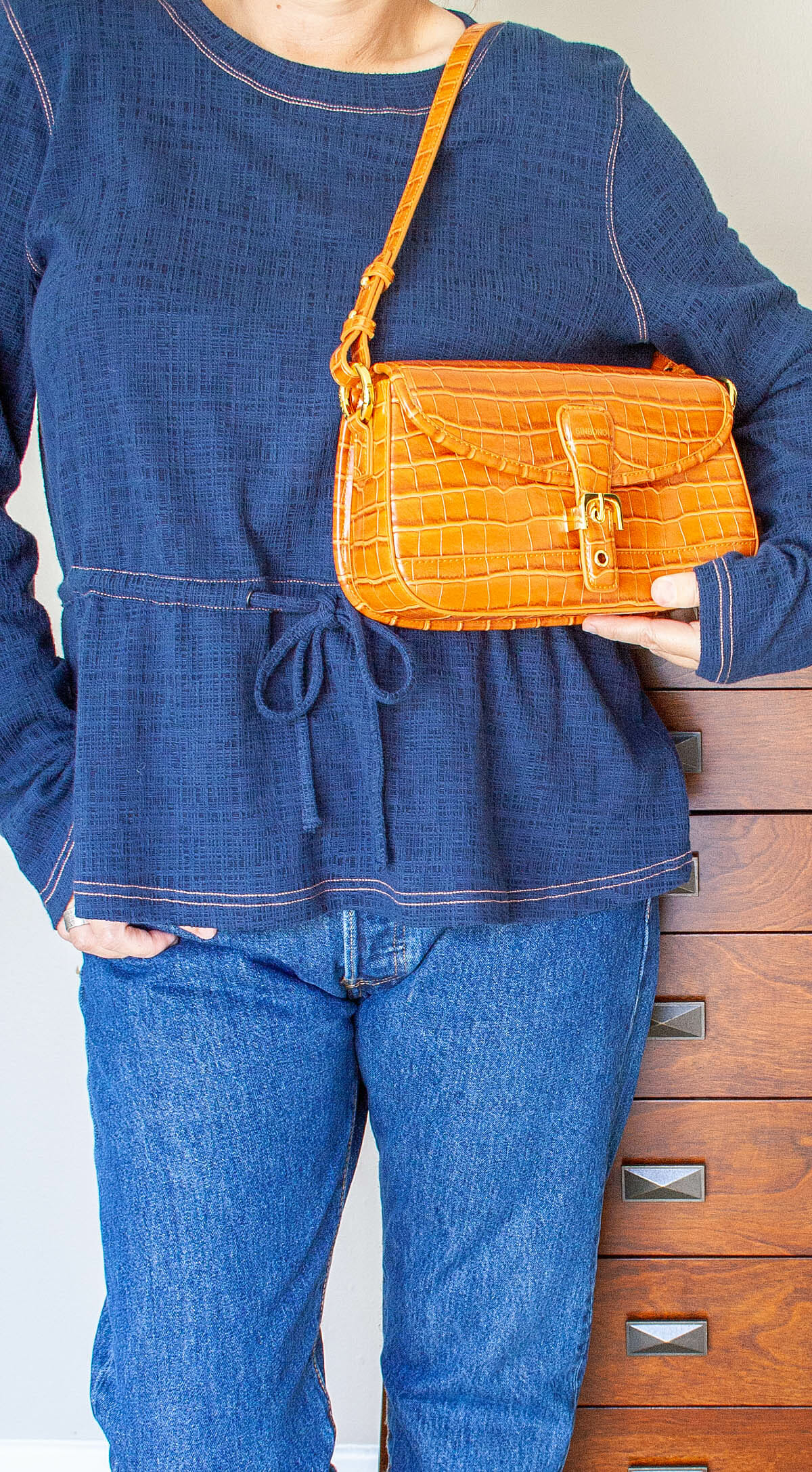 SINBONO Fiona Shoulder Bag worn on a woman with a blue shirt and blue jeans.
